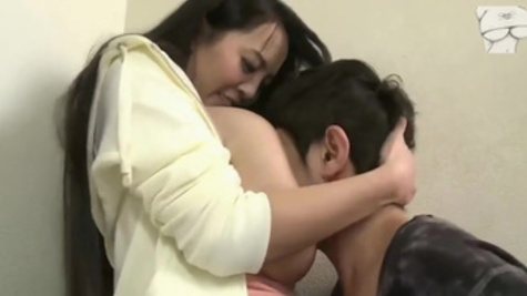 Japanese stacked MILF Hitomi Tanaka teaches boy about sex