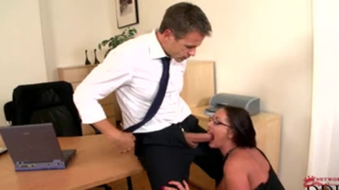 Big boobs Emma Butt gives a lusty blowjob during office hours