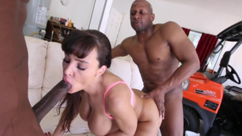 Lisa Ann serves two black male rods with her luscious twat