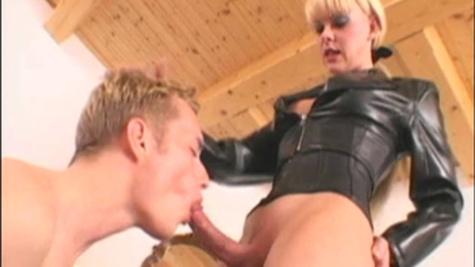 Shemale mistress Joanna Jet enjoys a lusty blowjob from slave