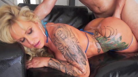 Hot Ryan Conner shows off her tattooed body while fucking
