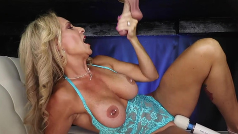 Cougar Kenzi Foxx milks penis while playing with vibrator