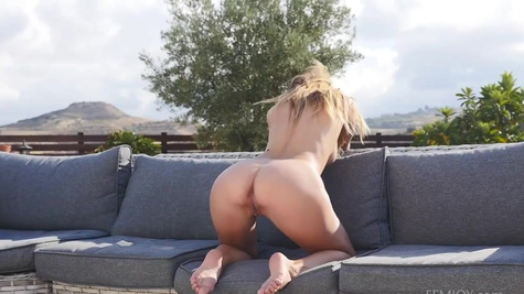 Winning Ukrainian adult model Cara Mell undresses outdoors