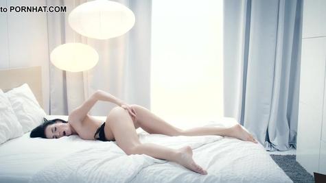 Teen with dark hair Sapphira masturbates in her bed