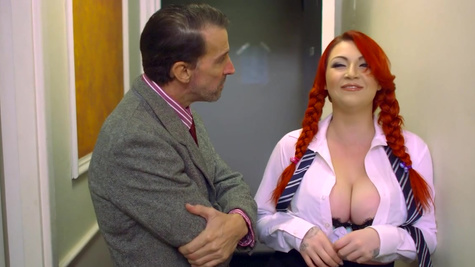 Redhead with huge tits delights with cock deep in her throat