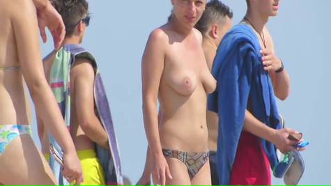 Young beauty chick with naked milkings on the beach